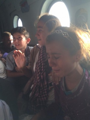 Yazidi children on board a rescue helicopter