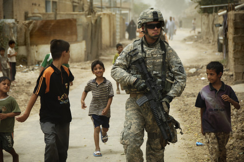 080804-A-8725H-341 Iraqi children gather around as U.S. Army Pfc. Shane Bordonado patrols the streets of Al Asiriyah, Iraq, on Aug. 4, 2008. Bordonado is assigned to 2nd Squadron, 14th Cavalry Regiment, 25th Infantry Division. DoD photo by Spc. Daniel Herrera, U.S. Army. (Released)